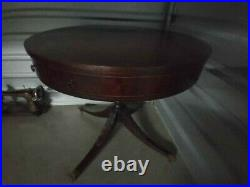 Antique Leather Top Round Table With Brass Casters And Droor