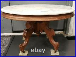 Ca. 1890 English Victorian Eastlake Style Carved Walnut Marble Top Coffee Table