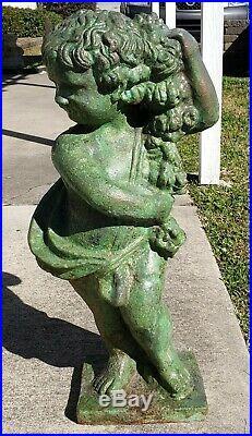 Circa 1880 English Victorian Bronze Patinated Cast Iron Putto Statue